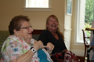 Edna and Dorris laughing about their shared time together.