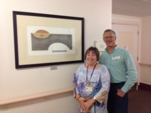 Bill Cohen and Ronnie Schechter standing by Shelia Springer Cohen's artwork