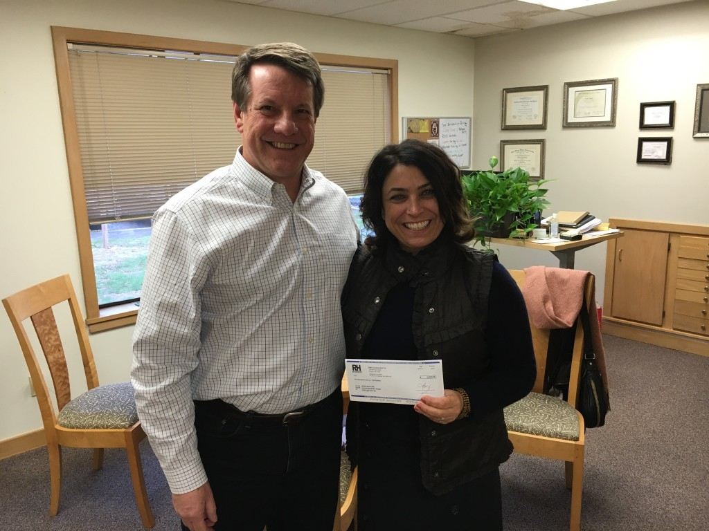 Norm Dowty of R&H Construction presents a $10,000 Diamond Sponsorship check to CSP CEO Sandra Simon